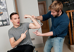 © Licensed to London News Pictures. 10/01/2013. London, UK Liam Payne gets measured for the waxwork model of himself. Madame Tussauds today, 11th March 2013, confirmed all five members of the successful band, One Direction, are to be created as wax figures for a touring attraction in three Madame Tussauds venues - London (April 18-July 11), New York (July 19-October 11) and Sydney (October 24- January 28).. Photo credit : Freerange/LNP