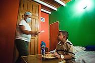 Manuel Alejandro Romero se prepara durante el almuerzo a tomar parte de sus medicinas gracias a la atención de su madre, Jaqueline Romero. Gracias a FundaHigado, en junio de 2012, Manuel Alejandro recibió un trasplante de higado que le permite disfrutar de la vida. Maracaibo, Venezuela 20 y 21 Oct. 2012. (Foto/ivan gonzalez)