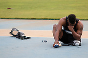 Michael Assefa, 24, sits on the ground, devastated, after the start of his race at the U.S. Paralympic Trials hosted at the Irwin Belk Complex in Charlotte, North Carolina, on Thursday, June 30, 2016. Assefa's running blade, parts of which are shown beside and behind him in the photo, snapped only seconds before the start of the Men's 200 Meter Dash 42, in which he hoped to qualify for the Rio 2016 Paralympics. (Photo/Casey Sykes, University of Georgia via AP)