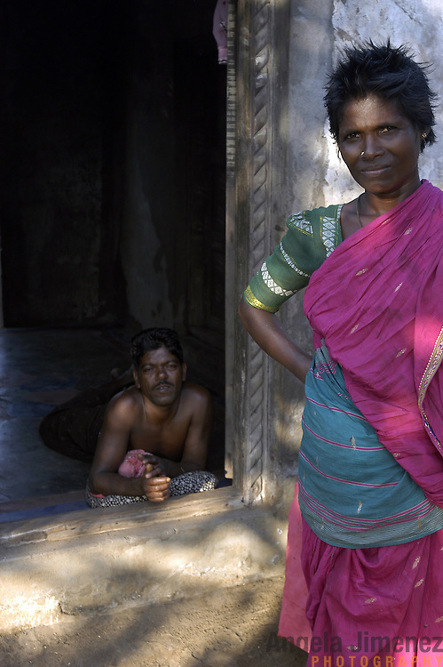 An unemployed fisherman, left, and his wife stand at their home in the fishing village of Perumalpettai, in Tamil Nadu, India on January 17, 2005, after the area was struck by the Indian Ocean Tsunami on December 26, 2004, killing 37 of the villagers and destroying nearly all of their fishing boats. Generated by an earthquake on the ocean floor, the tsunami devastated the fishing industry along the southeastern coast of India.