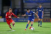 AFC Wimbledon midfielder Callum Reilly (33) dribbling during the Leasing.com EFL Trophy match between AFC Wimbledon and Leyton Orient at the Cherry Red Records Stadium, Kingston, England on 8 October 2019.