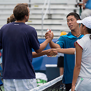 August 23, 2014, New Haven, CT:<br /> Jacqueline Cako and Joel Kielbowicz shake hands after defeating Ena and Shuhei Shibahara in the US Open National Playoffs mixed doubles finals on day nine of the 2014 Connecticut Open at the Yale University Tennis Center in New Haven, Connecticut Saturday, August 23, 2014.<br /> (Photo by Billie Weiss/Connecticut Open)