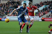 Bristol City defender Aden Flint  and Birmingham City midfielder Will Buckley watch the ball during the Sky Bet Championship match between Bristol City and Birmingham City at Ashton Gate, Bristol, England on 30 January 2016. Photo by Alan Franklin.