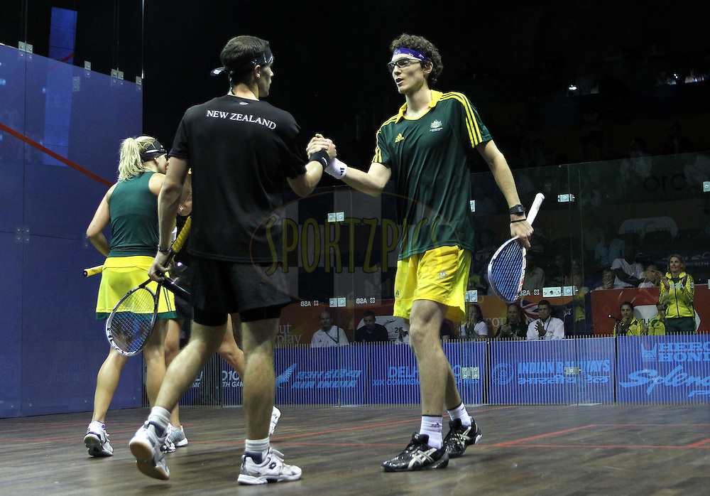 Kasey Brown and Cameron Pilley of Australia celebrate winning the gold medal by beating Joelle King and Martin Knight of New Zealand during the final of the mixed doubles squash competition held at the Siri Fort Complex in New Delhi as part of the XIX Commonwealth Games, India on the 13 October 2010..Photo by:  Ron Gaunt/photosport.co.nz