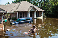 Volenteers helping evacuate people in Vidor Texas where the water continued to rise days after Hurricane Harvey first made landfall in Texas, in boats.