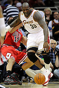 Apr 19, 2010; Cleveland, OH, USA; Cleveland Cavaliers center Shaquille O'Neal (33) runs into Chicago Bulls center Joakim Noah (13) during the third period in game two in the first round of the 2010 NBA playoffs at Quicken Loans Arena. The Cavaliers beat the Bulls 112-102. Mandatory Credit: Jason Miller-US PRESSWIRE
