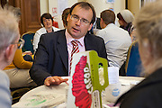 Gareth Thomas MP in discussion with his constituents at the Tea time for change event. Refreshing the call for justice. Organised by the UK's leading NGO's.  Enabling constituents to dicuss the subject with their MP.