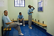 Prisoners in the waiting room for new arrivals on E wing. HMP Wandsworth, London, United Kingdom