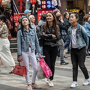 Tourists street photography in London Chinatown Sweet Tooth Cafe and Restaurant at Newport Court and Garret Street on 15 June 2019, UK.