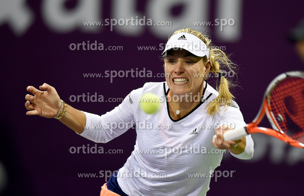Angelique Kerber of Germany returns the ball during the first round match against Victoria Azarenka of Belarus in the WTA Qatar Open tennis tournament in Doha, Qatar, Feb. 23, 2015. Angelique Kerber lost 0-2. EXPA Pictures &copy; 2015, PhotoCredit: EXPA/ Photoshot/ Chen Shaojin<br /> <br /> *****ATTENTION - for AUT, SLO, CRO, SRB, BIH, MAZ only*****
