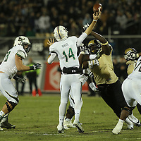 South Florida Bulls quarterback Mike White (14) throws a pass during an NCAA football game between the South Florida Bulls and the 17th ranked University of Central Florida Knights at Bright House Networks Stadium on Friday, November 29, 2013 in Orlando, Florida. (AP Photo/Alex Menendez)