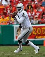 Quarterback JaMarcus Russell (2) of the Oakland Raiders drops back to pass in the third quarter against the Kansas City Chiefs at Arrowhead Stadium in Kansas City, Missouri on September 14, 2008...