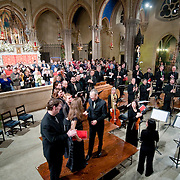 January 2, 2011 - Manhattan, NY : Musicians from the Green Mountain Project took part in a celebration of the 401st anniversary of Claudio Monteverdi's Vespers of 1610 at the Church of St. Mary the Virgin in Midtown Manhattan on Sunday night. Scott Metcalfe, center, graps the hand of Jolle Greenleaf as they prepare to take a bow.  //Assignment ID: 10105591A // Credit: Karsten Moran for the New York Times //