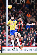 Yann Kermorgant challenges for the ball with Huddersfield Town's David Edgar during the Sky Bet Championship match between Bournemouth and Huddersfield Town at the Goldsands Stadium, Bournemouth, England on 14 February 2015. Photo by David Charbit.