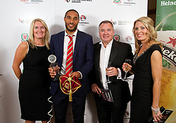 CARDIFF, WALES - Monday, October 6, 2014: Wales' captain Ashley Williams with xxxx, Cliff Fletcher and xxxx at the FAW Footballer of the Year Awards 2014 held at the St. David's Hotel. (Pic by David Rawcliffe/Propaganda)