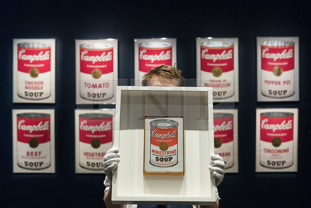 © Licensed to London News Pictures. 01/03/2019. LONDON, UK. A technician presents ''Little Campbell's Soup Can (Minestrone)'', 1962, (Est. £1,500,000 - 2,000,000) in front of ''Campbell's Soup I'', 1968, both by Andy Warhol, (Est. £300,000 - 400,000). Preview of Sotheby's Contemporary Art Sale in their New Bond Street galleries.  Works by artists including Tracey Emin, Jenny Saville, Jean-Michel Basquiat and Andy Warhol will be offered for auction on 5 March 2019.  Photo credit: Stephen Chung/LNP