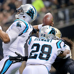 Dec 6, 2015; New Orleans, LA, USA; Carolina Panthers quarterback Cam Newton (1) is hit by New Orleans Saints outside linebacker Hau'oli Kikaha (44) during the first quarter of a game at Mercedes-Benz Superdome. Mandatory Credit: Derick E. Hingle-USA TODAY Sports