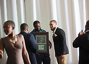 Kalvin McRae's family and friends get pictures with him after he gets accepted into The Kermit Blosser Ohio Athletics Hall of Fame at the Alumni Awards Gala on October 6, 2017.