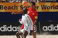 Football-FIFA Beach Soccer World Cup 2006 - Group D-BHR_NGA - Eyes in the ball. Hassan-BHR- and Omar-NGA- keeping the eyes on the ball. - Rio de Janeiro - Brazil 06/11/2006<br />Mandatory credit: FIFA/ Marco Antonio Rezende.