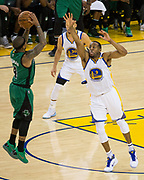 Boston Celtics guard Isaiah Thomas (4) gets a three pointer off before Golden State Warriors forward Andre Iguodala (9) can contest it late in the game at Oracle Arena in Oakland, Calif., on March 8, 2017. (Stan Olszewski/Special to S.F. Examiner)