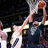 01 April 2018: Milwaukee Bucks center John Henson (31) is fouled by Denver Nuggets center Nikola Jokic (15) during the Denver Nuggets 128-125 victory over the Milwaukee Bucks, at the Pepsi Center, Denver, Colorado, USA.