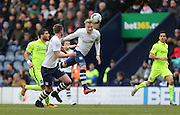 Preston North End Defender Tom Clarke (5) wins a header during the Sky Bet Championship match between Preston North End and Brighton and Hove Albion at Deepdale, Preston, England on 5 March 2016.