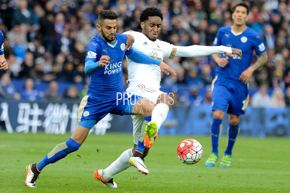 Swansea City midfielder Leroy Fer and Leicester City midfielder Riyad Mahrez tussle for the ball during the Barclays Premier League match between Leicester City and Swansea City at the King Power Stadium, Leicester, England on 24 April 2016. Photo by Alan Franklin.