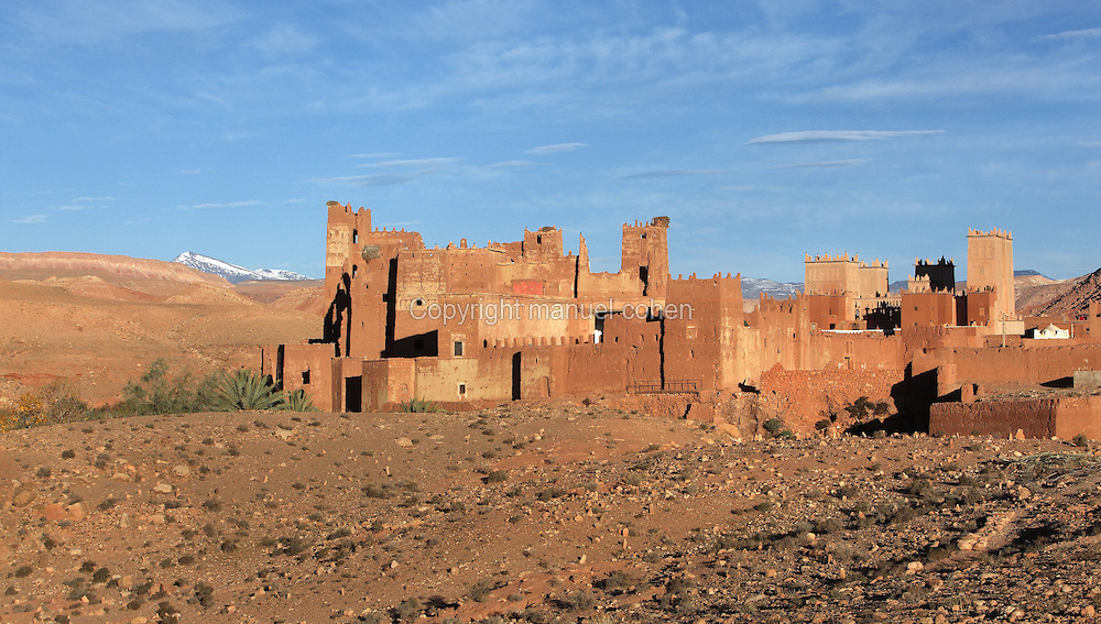Kasbah of the Glaoua family, Tamdaght, Ounila Valley, Ouarzazate province, High Atlas, Morocco. The Glaoua family ruled this area of Morocco from the late 19th century until Moroccan independence. This kasbah, a fortified earthen village, was built to house the Glaoua family chiefs, their families and a garrison. It sits on an ancient caravan route from the Sahara to Marrakech. Picture by Manuel Cohen