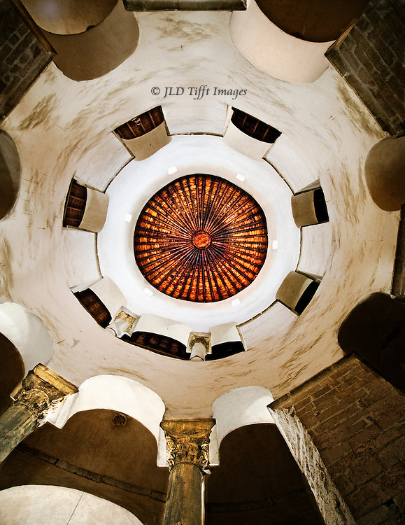 Whirling abstraction of circles and arches looking upward into the restored wooden dome interior of the Early Christian church of St. Donatus, Zadar, Croatia.