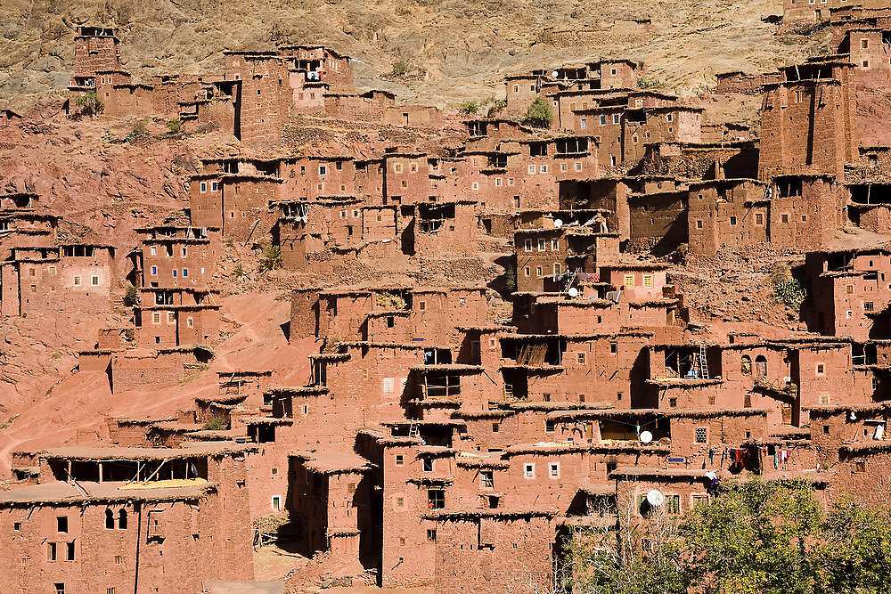 Stone and earth buildings built on a dramatic hillside in Magdaz, M'Goun Massif, Central High Atlas, Morocco.