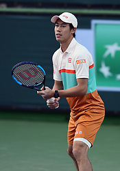 March 8, 2019 - Indian Wells, CA, U.S. - INDIAN WELLS, CA - MARCH 08: Kei Nishikori (JPN) waits for a serve in the second set of a doubles match during the BNP Paribas Open played at the Indian Wells Tennis Garden in Indian Wells, CA. (Photo by John Cordes/Icon Sportswire) (Credit Image: © John Cordes/Icon SMI via ZUMA Press)