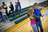 Daniel Gunnerson, 11, receives a hug from his sister Kimberly, 9, after he was awarded an iPod Touch and a certificate Monday at Dalton Elementary naming him the Idaho Math Champion for earning more points with the Apangea Learning program than any other student in the region.
