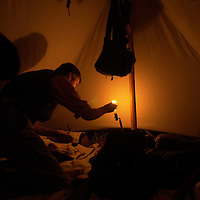 Matt Rhodes, a member of the Indiana Brigade, lights a candle in his tent on  Thursday night before the weekend-long events of the the Battle of  Perryville, a national Civil War Reenactment, in Perryville, Ky., on 10/3/02.