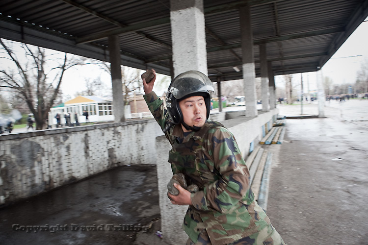 Here, an Interior Ministry soldier responded to rock-throwing rioters with his own rocks. April 7, 2010.