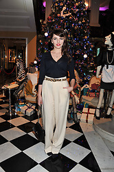 OPHELIA LOVIBOND at the unveiling of the Claridge's Christmas tree 2011 designed by Alber Elbaz for Lanvin held at Claridge's, Brook Street, London on 5th December 2011.
