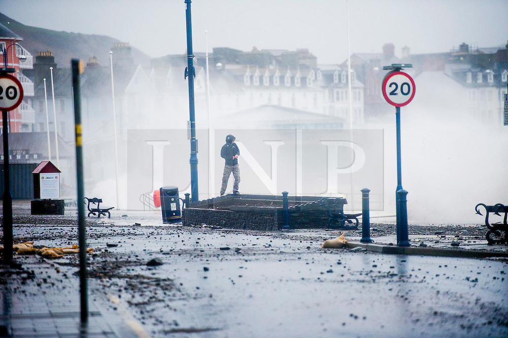 © London News Pictures. Aberystwyth, UK. 08/02/2016. Damage to the seafront as Gale force winds from Storm Imogen, the 9th named storm of the winter, combined with the peak of the tide, create huge waves  lashing against  the promenade and sea defences at Aberystwyth on the west Wales coast.  Much of southern England and South Wales is subject to yellow and amber weather warnings, with the risk of damaging gusts of wind and powerful waves along coastal areas. Keith Morris/LNP<br /> <br /> <br /> photo © Keith Morris