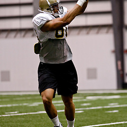 July 31, 2010; Metairie, LA, USA; New Orleans Saints tight end Jimmy Graham (80) catches a pass during a training camp practice at the New Orleans Saints indoor practice facility. Mandatory Credit: Derick E. Hingle