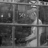 Female cutlery worker, Sydney Street, Sheffield 19 July 1983.