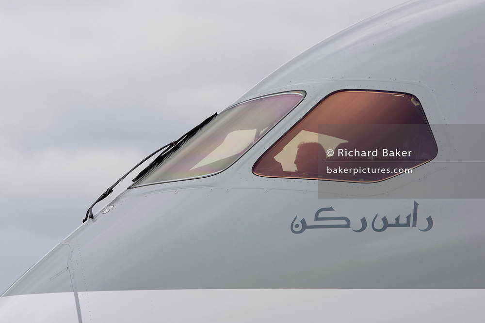 The cockpit window and nose design of a Qatar Airways Boeing 787 at the Farnborough Air Show, UK.