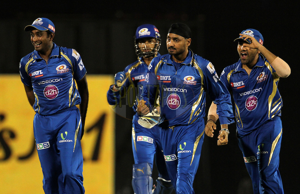 Mumbai Indians players celebrates the wicket of Faf du Plessis of The Chennai Superkings during the eliminator match of the Pepsi Indian Premier League Season 2014 between the Chennai Superkings and the Mumbai Indians held at the Brabourne Stadium, Mumbai, India on the 28th May  2014<br /> <br /> Photo by Vipin Pawar / IPL / SPORTZPICS<br /> <br /> <br /> <br /> Image use subject to terms and conditions which can be found here:  http://sportzpics.photoshelter.com/gallery/Pepsi-IPL-Image-terms-and-conditions/G00004VW1IVJ.gB0/C0000TScjhBM6ikg
