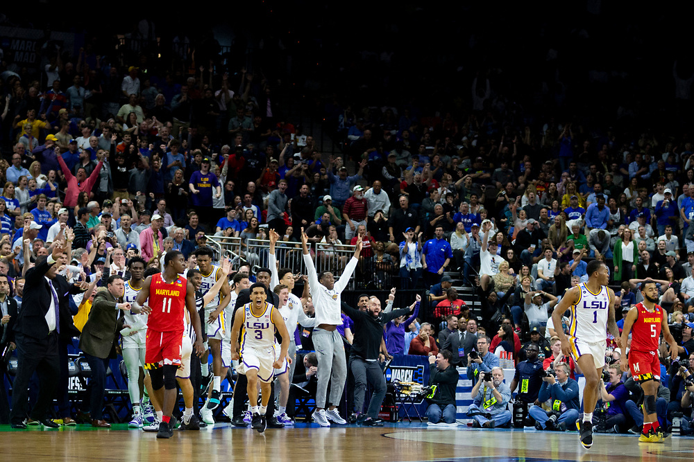 The LSU bench react to LSU guard Tremont Waters' three point play late in the second half of the second round men's college basketball game against Maryland in the NCAA Tournament, in Jacksonville, Fla. Saturday, March 23, 2019. (AP Photo/Stephen B. Morton)