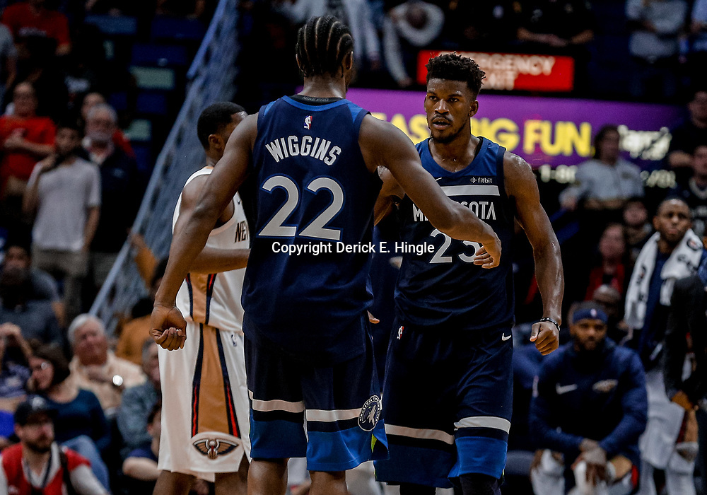 Nov 1, 2017; New Orleans, LA, USA; Minnesota Timberwolves guard Jimmy Butler (23) celebrates with forward Andrew Wiggins (22) after a basket and foul during the fourth quarter of a game against the New Orleans Pelicans at the Smoothie King Center. The Timberwolves defeated the Pelicans 104-98. Mandatory Credit: Derick E. Hingle-USA TODAY Sports