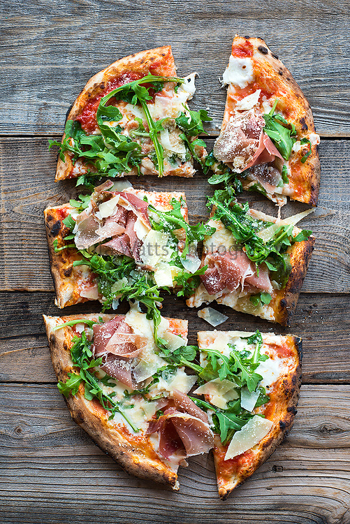 Pizza on rustic tabletop with overhead view