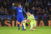Chelsea goalkeeper Thibaut Courtois (13) collects the ball with Leicester City forward Jamie Vardy (9) close by during the Premier League match between Leicester City and Chelsea at the King Power Stadium, Leicester, England on 14 January 2017. Photo by Jon Hobley.