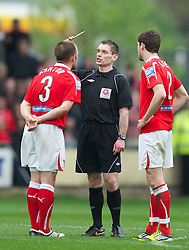 WREXHAM, WALES - Monday, May 7, 2012: Referee Steve Bratt shows the yellow card to.Wrexham's Neil Ashton against Luton Town during the Football Conference Premier Division Promotion Play-Off 2nd Leg at the Racecourse Ground. (Pic by David Rawcliffe/Propaganda)
