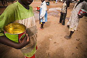 "Young students from a koranic school beg on the streets of Koungheul, Senegal, on Tuesday June 19, 2007. The boys, locally called ""talibes"" are sent to beg on the streets by the school's religious leaders. Across Senegal, they typically use empty tomato tin cans to collect donations of food, money or other goods."