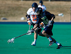 Navy defenseman Zack Schroeder (51) beats Virginia midfielder Garett Ince (15) to a loose ball.  The Virginia Cavaliers scrimmaged the Navy Midshipmen in lacrosse at the University Hall Turf Field  in Charlottesville, VA on February 2, 2008.