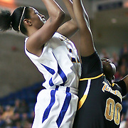 Delaware Sophomore Forward (#12) Danielle Parker drives to the hoop in the first half, Parker finished with 9 points as Delaware defeated Towson 75-57 Wednesday at The Bob Carpenter Center In Newark Delaware...Special to The News Journal/SAQUAN STIMPSON