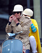 A mod couple sitting on their scooter in London, UK, 2010