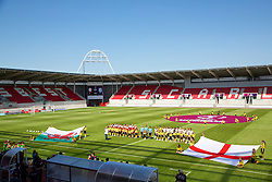 LLANELLI, WALES - Thursday, August 22, 2013: Wales line-up to take on England before the Group A match of the UEFA Women's Under-19 Championship Wales 2013 tournament at Parc y Scarlets. (Pic by David Rawcliffe/Propaganda)